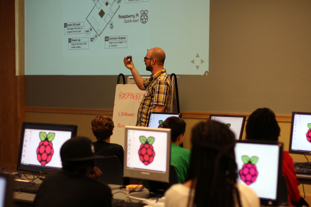 2013 Teen Tech Camp lead instructor Clinton Dreisbach explaining the workings of a Raspberry Pi