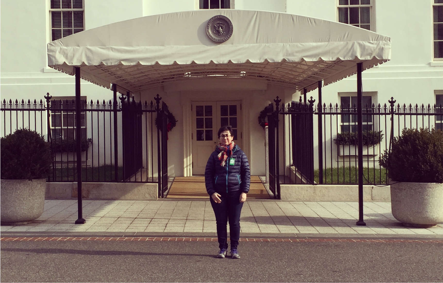 Julia Elman in front of the entrance to the West Wing, The White House